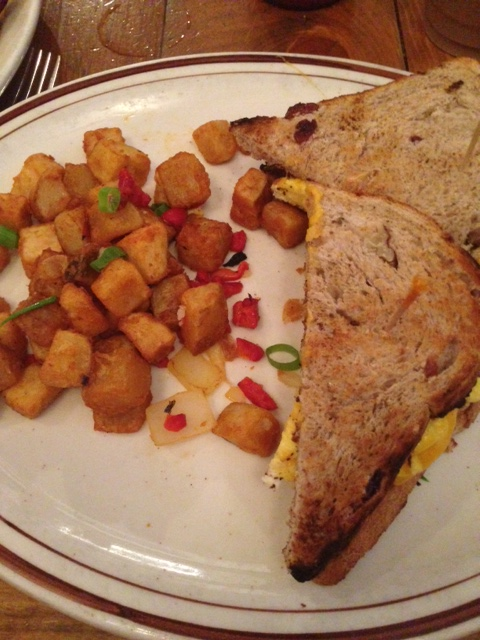 sausage, egg & cheese on cranberry whole wheat bread & potatoes @ Grey Dog Cafe
