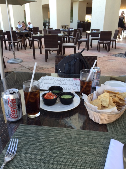 The best view ever... diet coke, chips and guac on the beach!