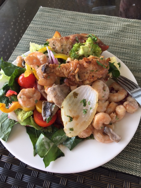 Fresh veggies & seafood on salad for lunch in Mexico!